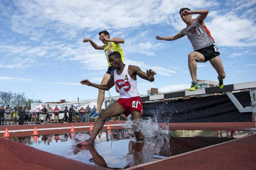 WKU%27s+Peter+Agaba+splashes+into+a+pool+of+water+during+the+steeplechase+event+during+the+Hilltopper+Relays+Saturday+at+the+Charles+M.+Ruter+Track+and+Field+Complex+in+Bowling+Green%2C+Ky.+Nick+Wagner%2FHERALD