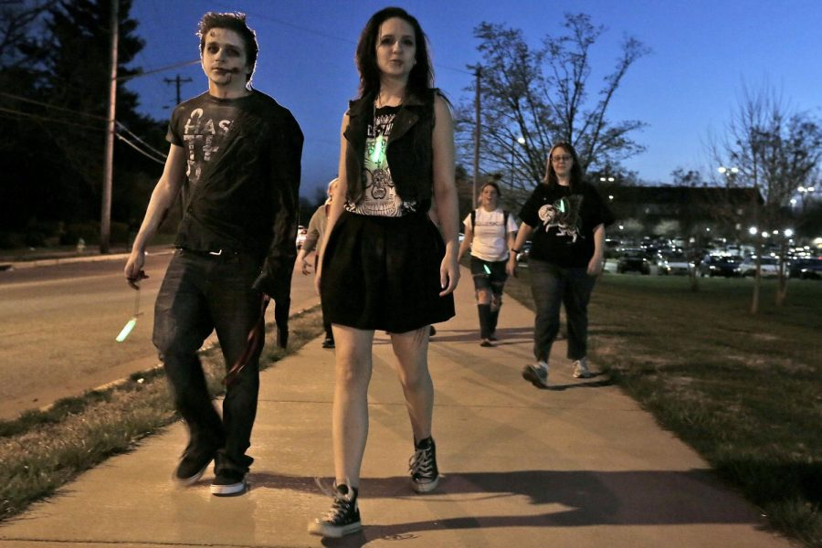 Elizabethtown senior Andrew Crum (left) and Staten Island senior Allison Call walk along Normal Drive during the inaugural Zombie-Walk event, hosted by the Housing and Residence Life, Tuesday, March 31. It consisted of a one-mile walk around campus followed by snacks and a costume contest. WKU HRL hosted a Zombie Walk around the southern end of campus. About 50 people attended, many in costume. Leanora Benkato/HERALD
