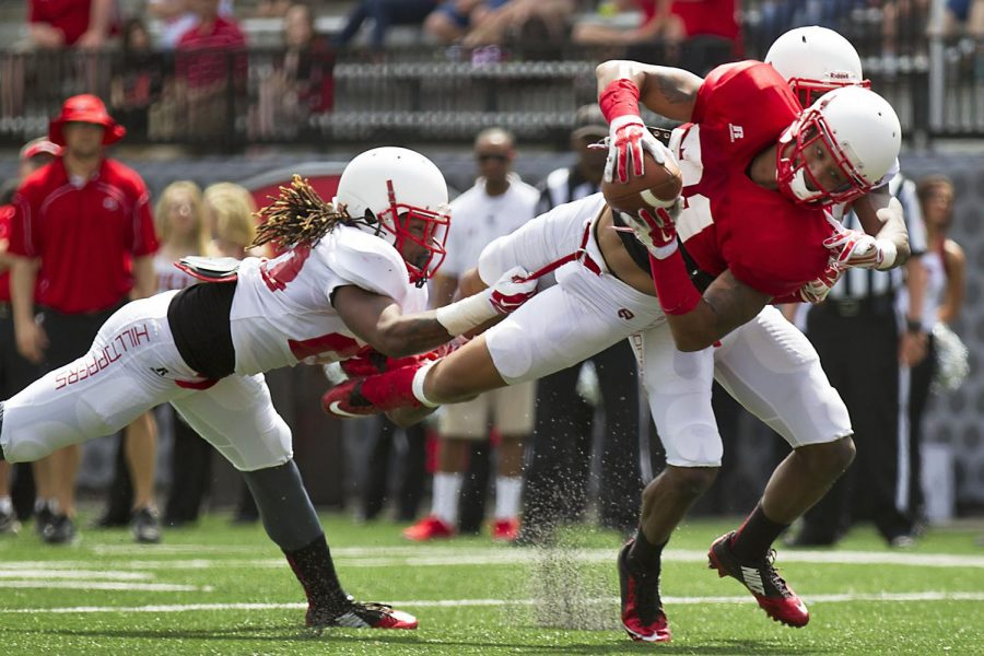 WKU%27s+wide+receiver+Jared+Dangerfield+%2821%29+dives+past+cornerback+De%27Andre+Simmons+%2823%29+towards+the+goal+line+during+WKU%27s+Red+vs.+White+spring+football+game+Saturday%2C+April+18%2C+2015%2C+at+Houchens+Industries+-+L.T.+Smith+Stadium+in+Bowling+Green%2C+Ky.+Dangerfield+was+ruled+down+at+the+one+yard+line.+The+Red+vs.+White+game+caps+the+end+of+five+weeks+of+spring+training+for+the+Hilltopper%27s.+The+2015+season+begins+September+5%2C+2015+when+the+Hilltopper%27s+take+on+Vanderbilt+in+Nashville.+MIKE+CLARK%2FHERALD