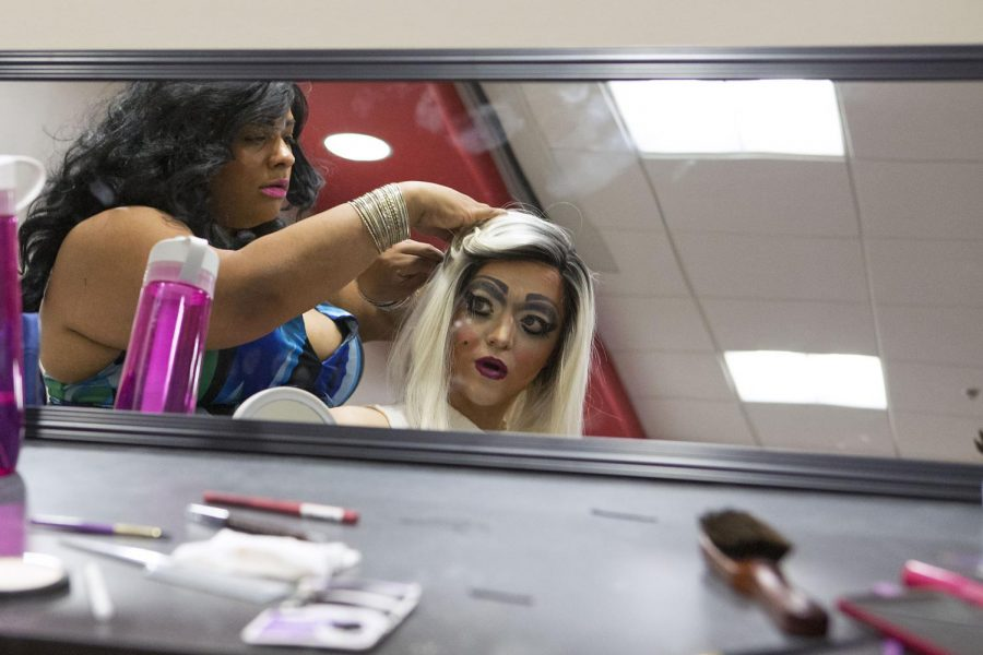 Summerset junior Jarred Johnson has his hair pinned by Briana Black before performing as Coal in the Drag Show hosted by Residence and Housing Life Saturday, April 25, 2015, in the Downing Student Union. Johnson said he was inspired to perform in drag by watching RuPaul's Drag Race. Mike Clark/HERALD