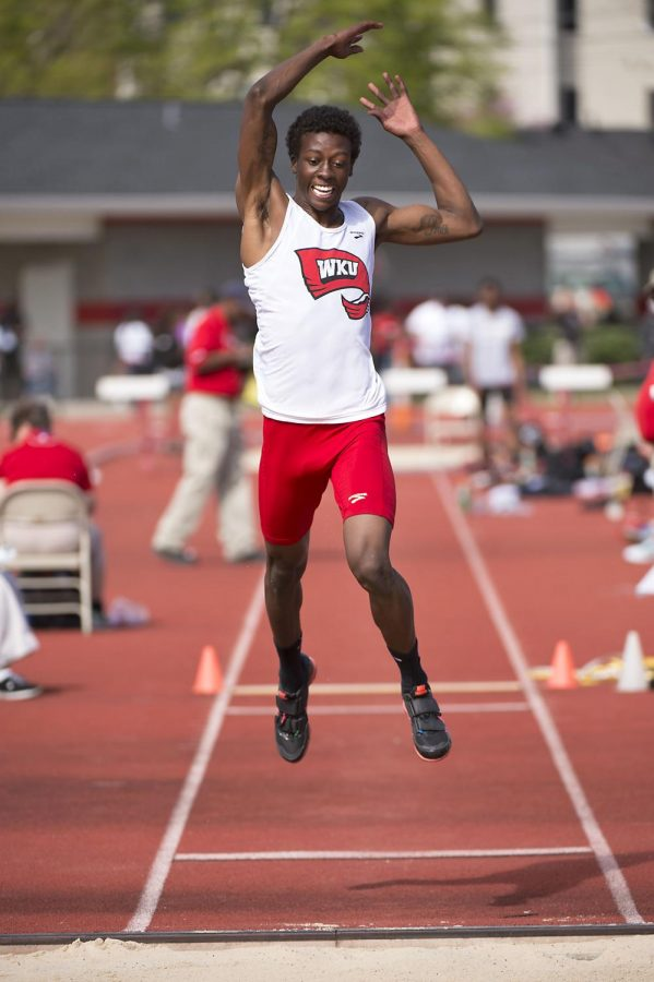Ventavius Sears leaps toward the sand pit during the triple jump competition in the Hilltopper Relays Saturday at the Charles M. Ruter Track and Field Complex in Bowling Green. Sears took first with a personal-record jump of 51-feet-6.5 inches. Nick Wagner/HERALD