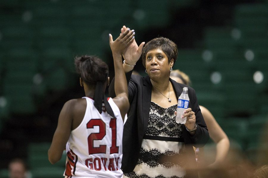 WKU's head coach Michelle Clark-Heard highfives senior guard Alexis Govan (21) during the Hilltopper's 70-67 win over Charlotte in the second round of the Conference USA tournament Thursday, March 12, 2015, at Bartow Arena in Birmingham, Ala. Govan led the game with 21 points. The Lady Toppers take on either Old Dominion or UTSA The Lady Toppers take on either Old Dominion or UTSA in the semifinal game at 12:30 p.m. Friday March 13, 2015.