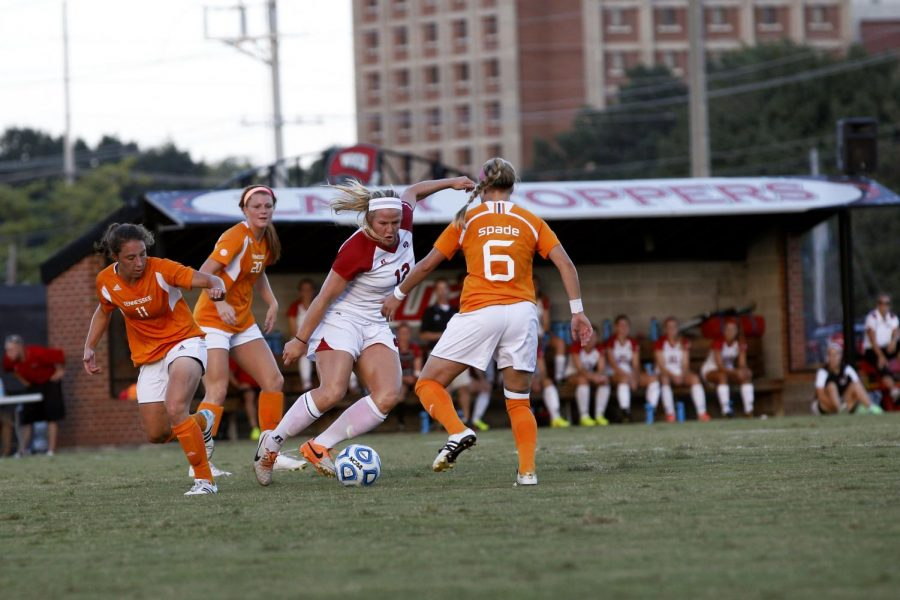 Sophomore forward Iris Dunn battles University of Tennessee's Carlyn Baldwin (11), Susan Ferguson (20), and Cheyenne Spade (6) for possession of the ball during the first half of WKU's Sept. 5 match. The Lady Hilltoppers lost 2-0 to the Lady Volunteers. Brandon Carter/HERALD