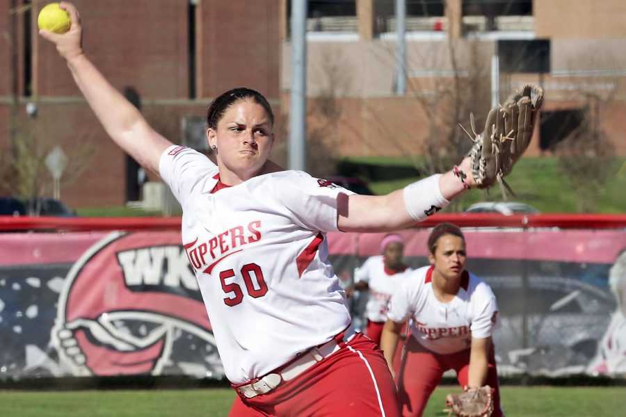 Cartersville, Ga., Lady Topper softball senior pitcher, Janna Scheff, winds up on the pitching mound during the softball double header against Florida Atlantic at the Softball Complex, Saturday, April 4, 2015 . Leanora Benkato/ HERALD