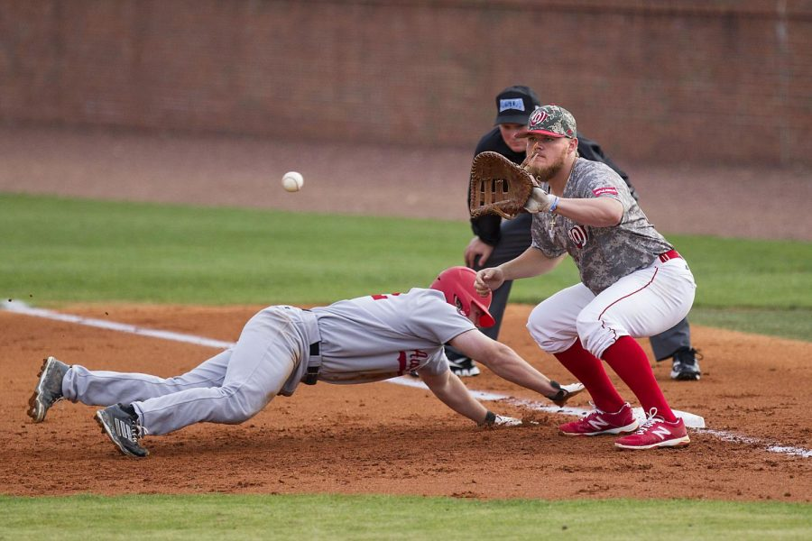 WKU+senior+infielder%2C+Ryan+Church%2C+of+West+Palm+Beach+Florida+attempts+to+catch+a+ball+thrown+his+way+while+Austin+Peay+outfielder%2C+Cayce+Bredlau%2C+of+Clarksville%2C+Tennessee%2C+slides+to+first+base+at+Nick+Deans+Field%2C+Tuesday%2C+April+28%2C+2015.+The+Hilltoppers+beat+the+Governors%2C+6-5.+Mike+Clark%2FHERALD