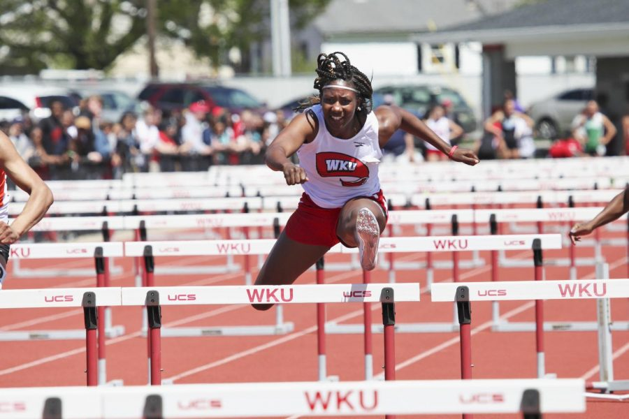 Senior+Jatavia+Wright+clears+a+hurdle+during+the+WKU+Hilltopper+Relays+April+11%2C+2015+at+Charles+M.+Rueter+Track+and+Field+Complex.+Ashley+Cooper%2FHERALD