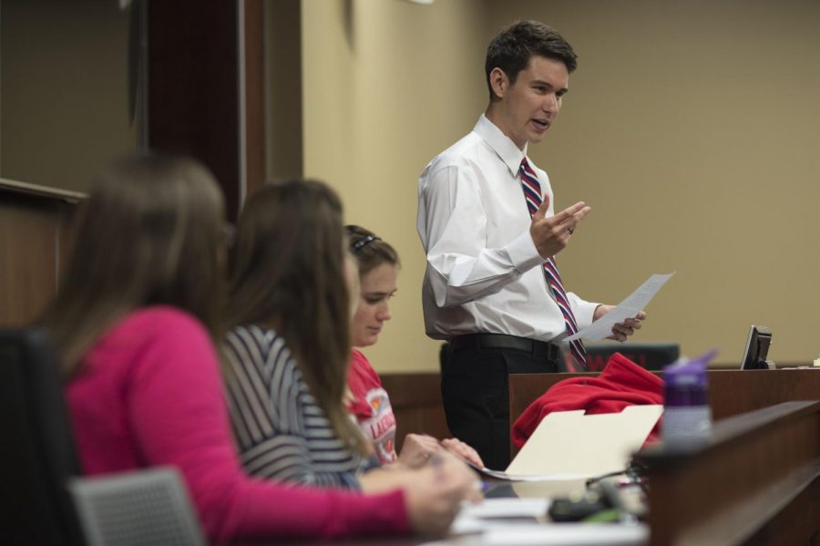 Jay Todd Richey addresses fellow Student Government Association members on Thursday, April 16, 2015, during a special hearing to finalize the decision on controversies over the 2015 presidential election. Anonymous accusations accused Richey of disobeying SGA election codes by placing posters in prohibited locations on campus. The SGA judicial council warned Richey against violating election codes in the future and stated he rightfully won the election. WILLIAM KOLB/HERALD