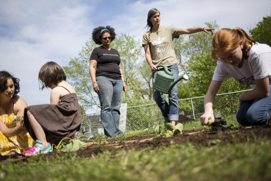 WKU grad student Beth McGrew helps direct volunteer efforts during during the Earth Day Garden Party Wednesday April 22 at the Office of Sustainability on WKU's campus. The party was sponsored by Project Grow and also the WKU Student Government Association. Luke Franke/Herald