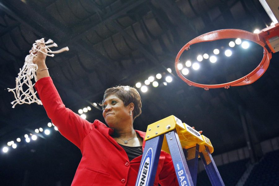 WKU Women's Head Coach Michelle Clark-Heard cuts down the net following her team's championship victory against Southern Miss. in the Conference USA tournament championship Friday March 14, 2015 at Legacy Arena in Birmingham, Ala. The victory clinched a NCAA tournament spot for the Lady Toppers and vaulted their record to 30-4. Luke Franke/HERALD