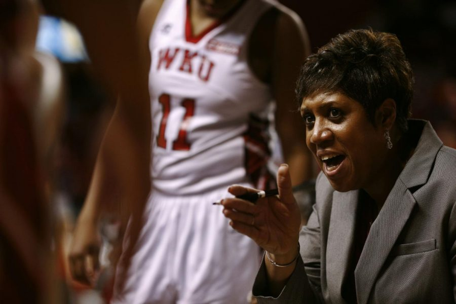 WKU+head+coach+Michelle+Clark-Heard+fires+up+the+team+during+a+timeout+in+the+second+half+of+the+team%27s+in-conference+matchup+against+MTSU.+WKU+would+go+on+to+defeat+conference+rival+MTSU+in+a+game+that+went+down+to+the+final+buzzer+by+a+score+of+63-60.+Placing+them+at+the+top+of+the+current+Conference+USA+standings.+%28Luke+Franke%2FHerald%29