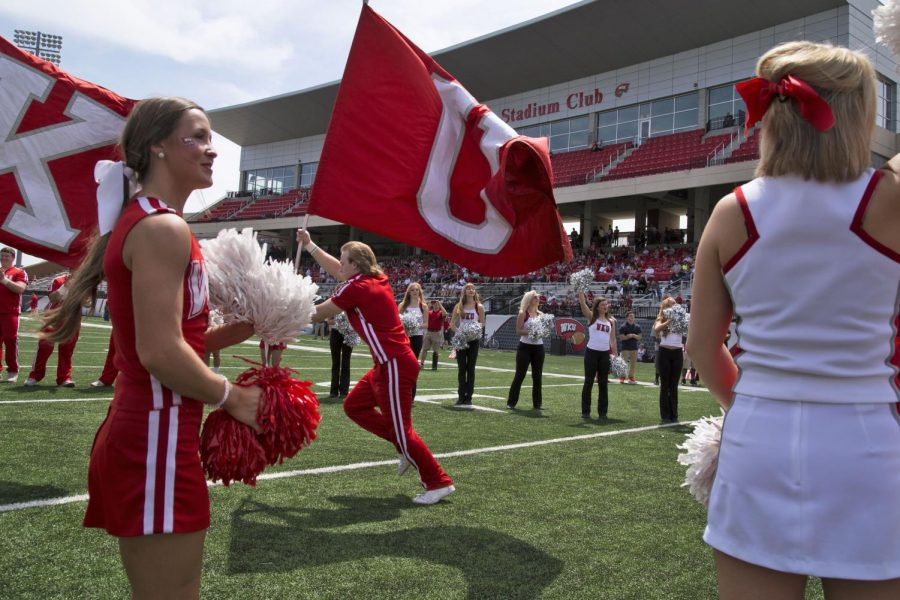WKU+cheerleaders+lead+the+Hilltopper%27s+onto+the+field+before+the+start+of+WKU%27s+Red+vs.+White+spring+football+game+Saturday%2C+April+18%2C+2015%2C+at+Houchens+Industries+-+L.T.+Smith+Stadium+in+Bowling+Green%2C+Ky.+The+Red+vs.+White+game+caps+the+end+of+five+weeks+of+spring+training+for+the+Hilltopper%27s.+The+2015+season+begins+September+5%2C+2015+when+the+Hilltopper%27s+take+on+Vanderbilt+in+Nashville.%C2%A0Mike+Clark%2FHERALD