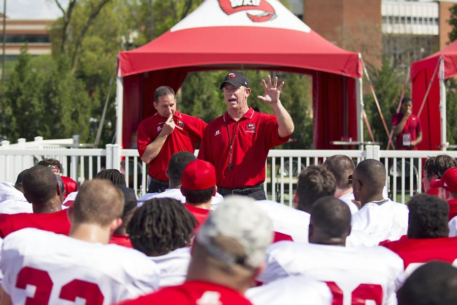 WKUs head footbal coach Jeff Brohm encourages the team after WKUs Red vs. White spring football game Saturday, April 18, 2015, at Houchens Industries L.T. Smith Stadium in Bowling Green, Ky. Mike Clarke/HERALD ARCHIVE