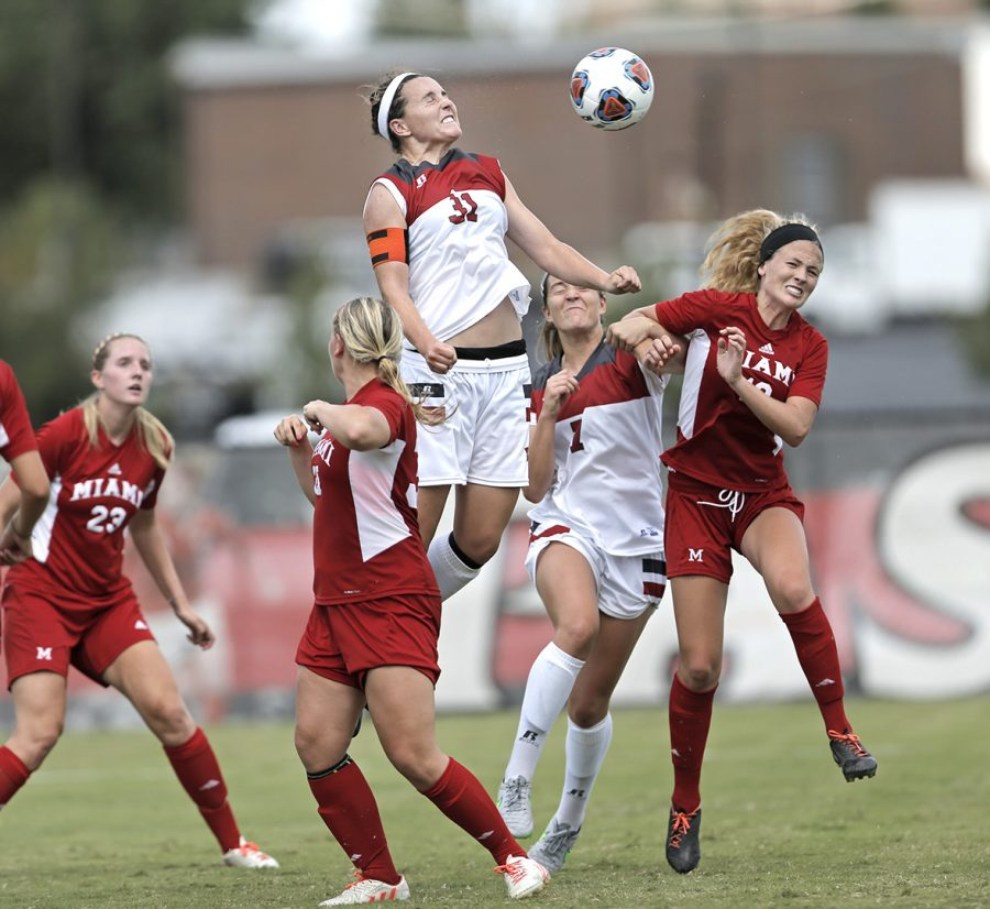 WKU%27s+defender+Chandler+Clark+%2831%29+heads+the+ball+as+WKU%27s+midfielder+Haley+Baldridge+%287%29+and+Miami+Universities+defender+Katie+Mazurek+%2810%29+fight+for+possession+during+WKU%27s+0-4+loss+to+Miami+on+Sunday+Aug.+23%2C+2015+at+the+WKU+Soccer+Complex+is+Bowling+Green%2C+Ky.