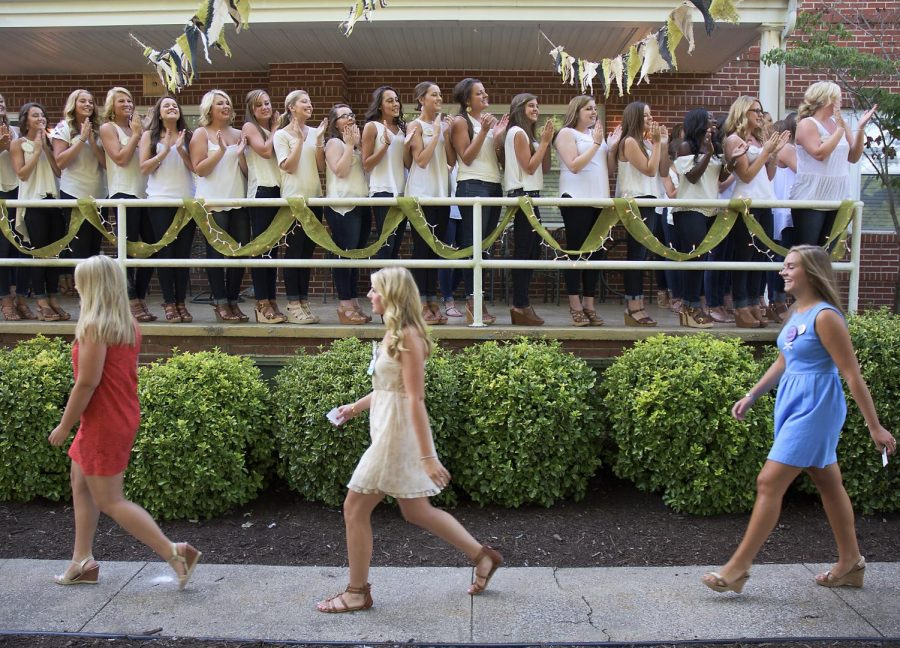 Kappa+Delta+sorority+members+greet+potential+new+members%2C+PNMs%2C+with+their+Kappa+Delta+welcome+cheer+at+the+Kappa+Delta+House+on+Thursday%2C+Aug.20%2C+2015.+Abbey+Tanner%2FHERALD