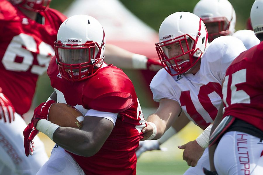 WKUs running back Leon Allen (33) tries to get around linebacker Nick Holt (10) during WKUs Red vs. White spring football game Saturday, April 18, 2015, at Houchens Industries - L.T. Smith Stadium in Bowling Green, Ky. The Red vs. White game caps the end of five weeks of spring training for the Hilltoppers. The 2015 season begins September 5, 2015 when the Hilltoppers take on Vanderbilt in Nashville. MIKE CLARK/HERALD