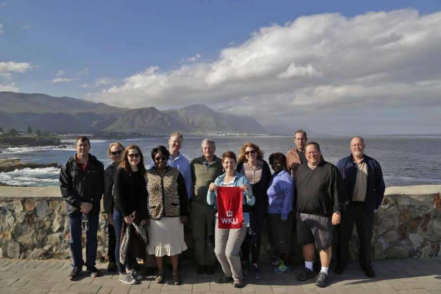 WKU faculty stand by the ocean in Hermanus, South Africa on May 24, 2015. The International Year Of ... (IYO) program is designed to provide the WKU campus and surrounding community with a rich, complex sense of place and interconnectedness through a year-long celebration and emphasis on a single country/region. The Zuheir Sofia Endowed International Faculty Seminar (ZSEIFS) is a key component of the IYO and is intended to enhance the overall objectives of the IYO through an intense interdisciplinary development opportunity for faculty centering on the region/country of focus.