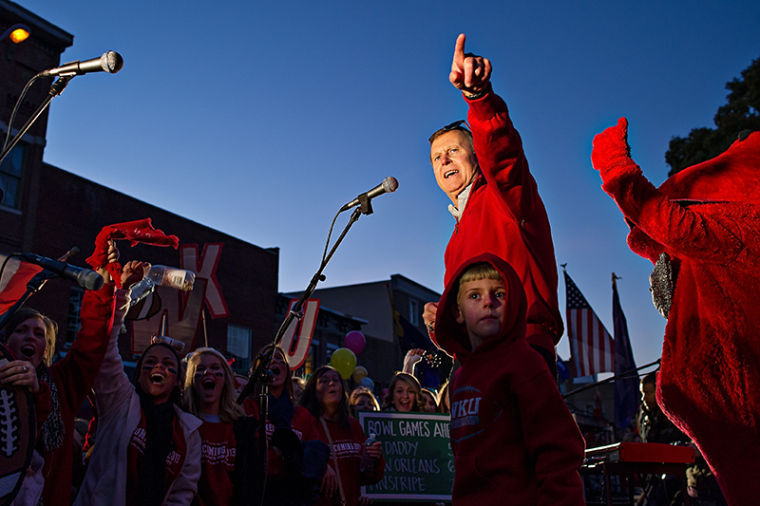Former president Gary Ransdell talks to the crowd during Big Red's Roar after WKU's homecoming parade to the square on Oct. 25, 2013.