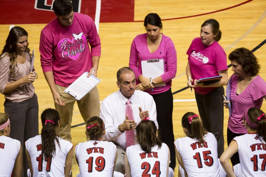 Head Coach Travis Hudson gives the volleyball team a talk during the game against Tennessee Tech on Tuesday. Brandon Carter/HERALD