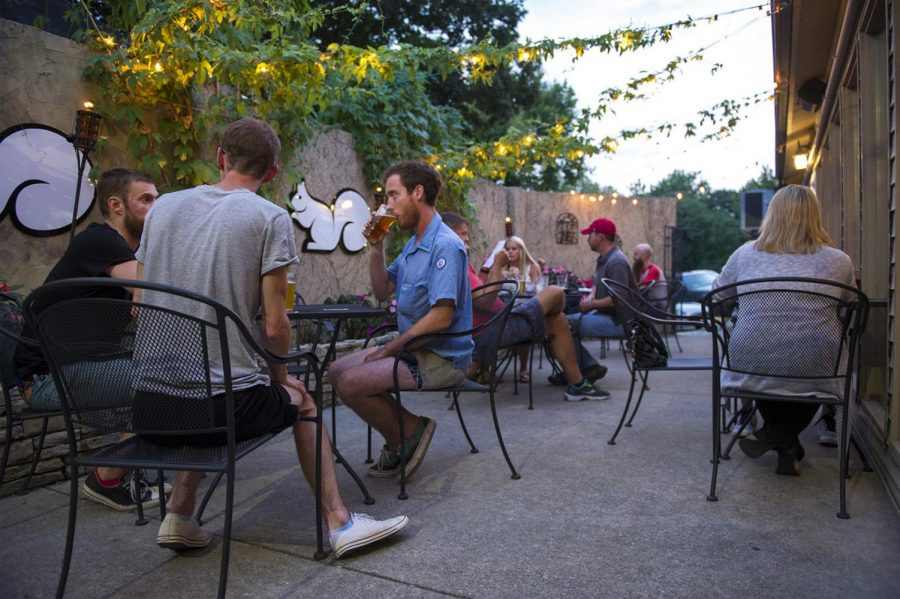 Customers take advantage of the open air patio at White Squirrel Brewery on Broadway in Bowling Green on Tuesday. The bar and restaurant opened over four months ago and is finding its taps flowing and seats occupied on a nightly basis.
