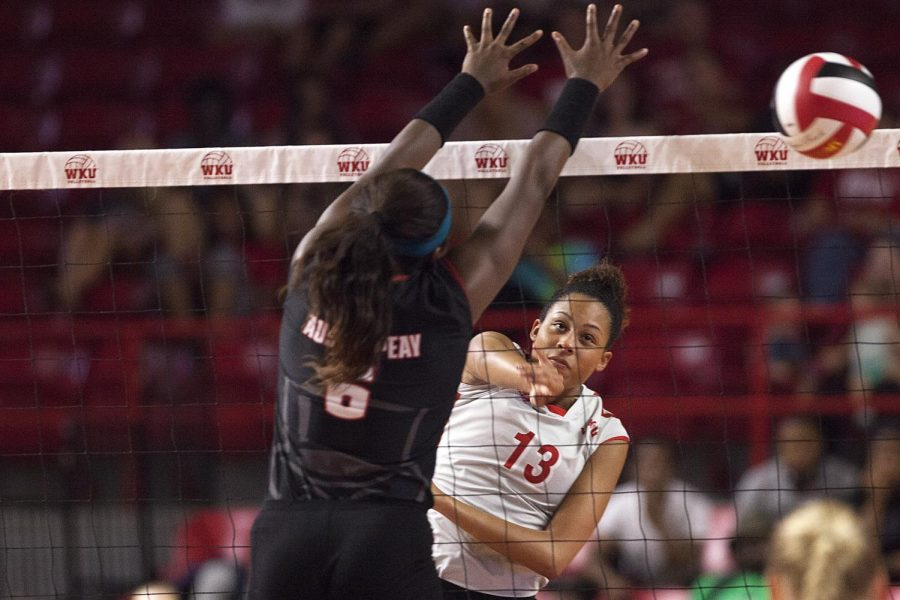 Lady+Hilltopper+Volleyball+senior+middle+hitter%2C+Noelle+Langenkampp+%2813%29+hits+the+ball+past+Austin+Peay+middle+blocker%2C+Ashley+Slay+%286%29+during+the+Lady+topper+3-0+win+against+Austin+Peay+volleyball+game+on+Tuesday+at+E.A.+Diddle+Arena+in+Bowling+Green.+Shaban+Athuman%2FHERALD
