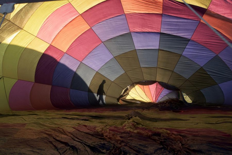 Pilot Dave Bobel of Rochester, In., examines the external part of his hot air balloon to make sure there are no problems before he takes off in the balloon race on Sunday.