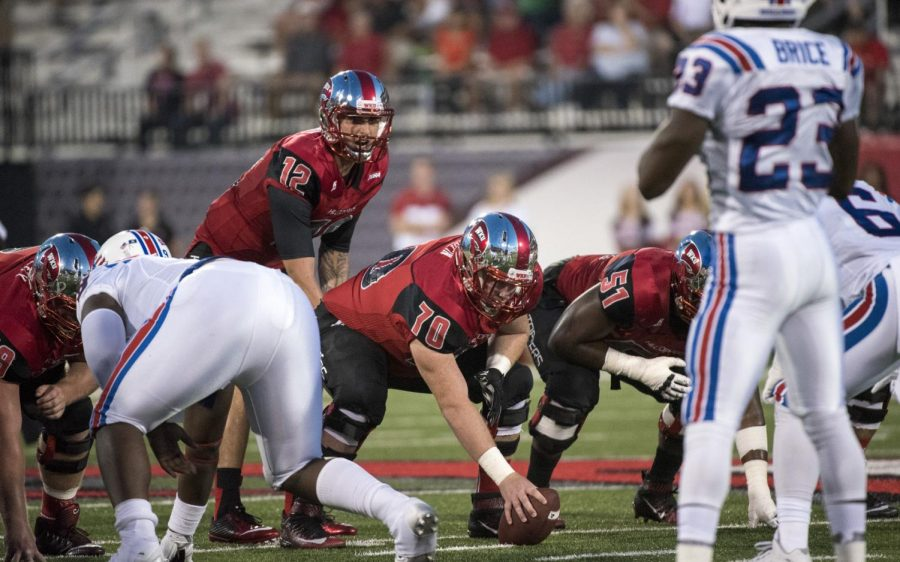 WKU+offensive+lineman+Max+Halpin+%2870%29+prepares+to+snap+the+ball+to+quarterback+Brandon+Doughty+%2812%29+during+the+Hilltoppers+41-38+win+over+Louisiana+Tech+Thursday+at+Houchens+Industries+-+L.T.+Smith+Stadium.