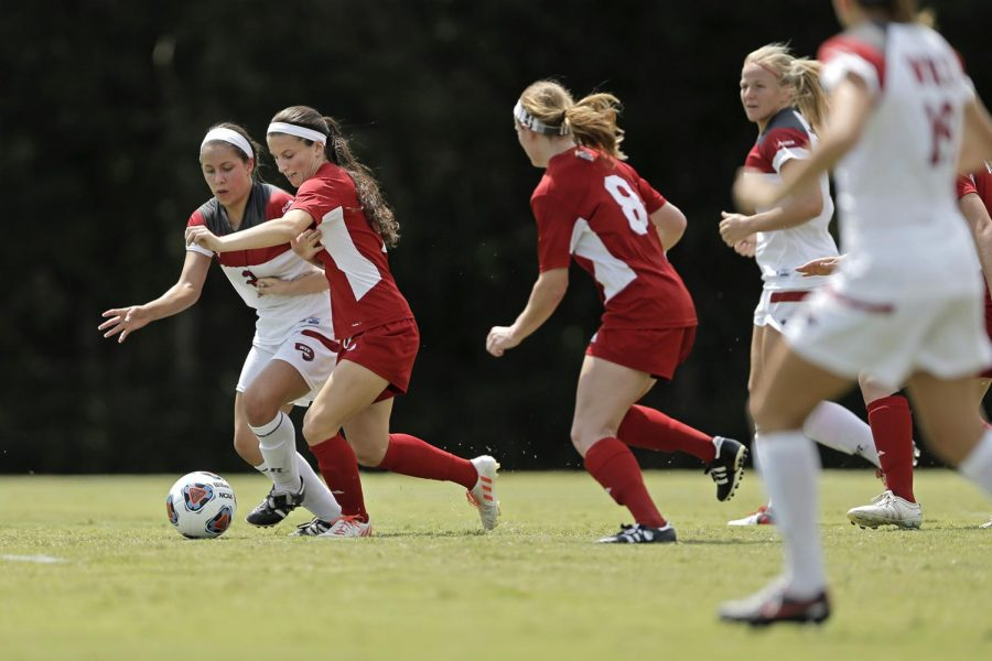 WKU's midfielder Hannah Chua (2) attempts to steal the ball from Miami Universities defender Tori Christiansen (2) during WKU's 0-4 loss to Miami on Sunday Aug. 23, 2015 at the WKU Soccer Complex is Bowling Green, Ky.