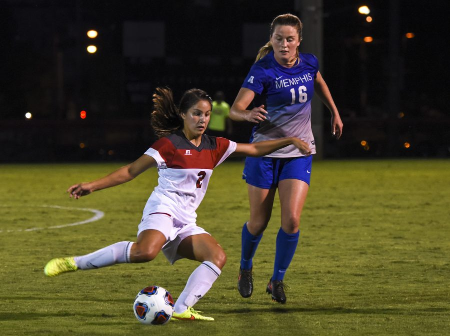 WKU+midfielder+Hannah+Chua+%282%29+moves+the+ball+downfield+as+Memphis+University+defender+Olivia+Gauthier+%2816%29+challenges+her+during+the+second+half+of+the+Lady+Toppers%27+2-1+win+Friday+night+at+the+WKU+Soccer+Complex.+Chua+scored+from+outside+the+box+late+in+the+match+to+give+the+Lady+Tops+the+win.+Gabriel+Scarlett%2FHERALD