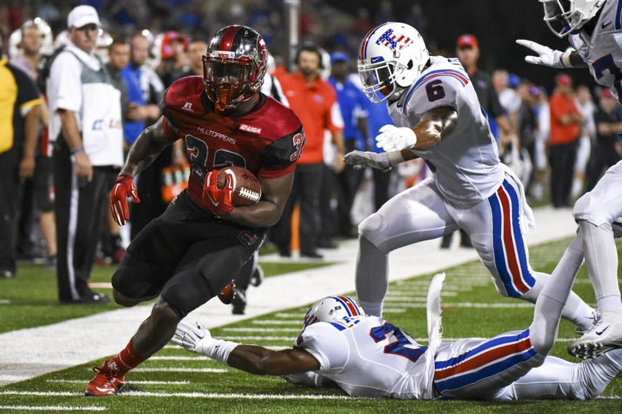 WKU running back Leon Allen (33) dodges a tackle during the first half of the Hilltoppers 41-38 win over Louisiana Tech Thursday at Houchens Industries - L.T. Smith Stadium.