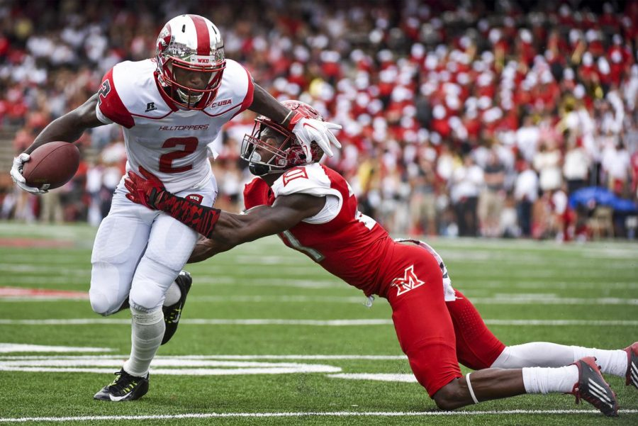 WKU+wide+receiver+Taiwan+Taylor+%282%29+tries+to+get+around+University+of+Miami+%28Ohio%29+defensive+back+Marshall+Taylor+%2821%29+during+the+Hilltoppers%27+56-14+win+against+the+University+of+Miami+%28Ohio%29+on+Saturday+at+Houchens+Industries-L.T.+Smith+Stadium.