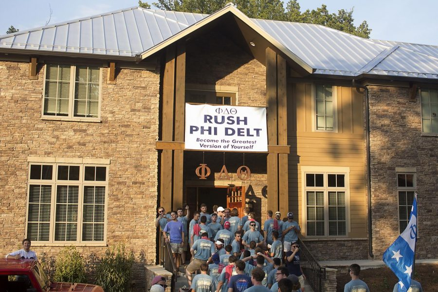 Phi Delta Theta members prepare to take a group photo with their new pledges on Saturday, Aug. 29, at the Phi Delta Theta house. The fraternity moved into its newly built home this semester after being recolonized two years ago.