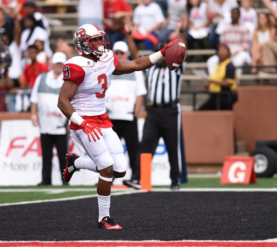 WKU wide receiver Antwane Grant (3) celebrates after scoring the first of the Hilltoppers' eight touchdowns against Miami (Ohio) during the Hilltoppers 56-14 win Saturday at Houchens Industries-L.T. Smith Stadium.