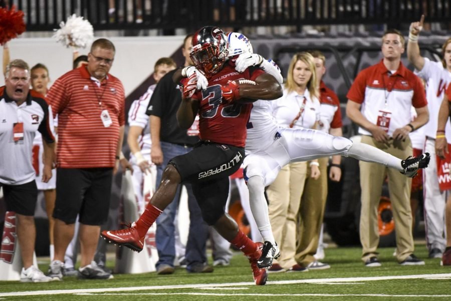 WKU+running+back+Leon+Allen+%2833%29+attempts+to+shake+a+tackle+during+the+Hilltoppers+41-38+win+over+Louisiana+Tech+Thursday+at+Houchens+Industries+-+L.T.+Smith+Stadium.