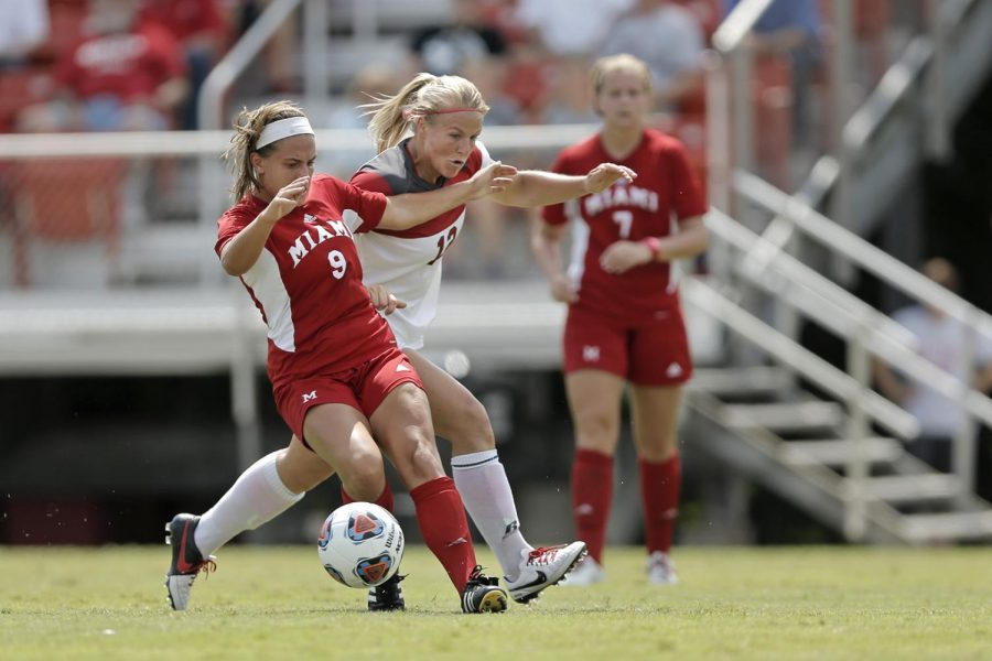WKU's forward Iris Dunn (12) attempts to steal the ball from Miami Universities midfielder Amy Malone (9) during WKU's 0-4 loss to Miami on Sunday Aug. 23, 2015 at the WKU Soccer Complex is Bowling Green, Ky.