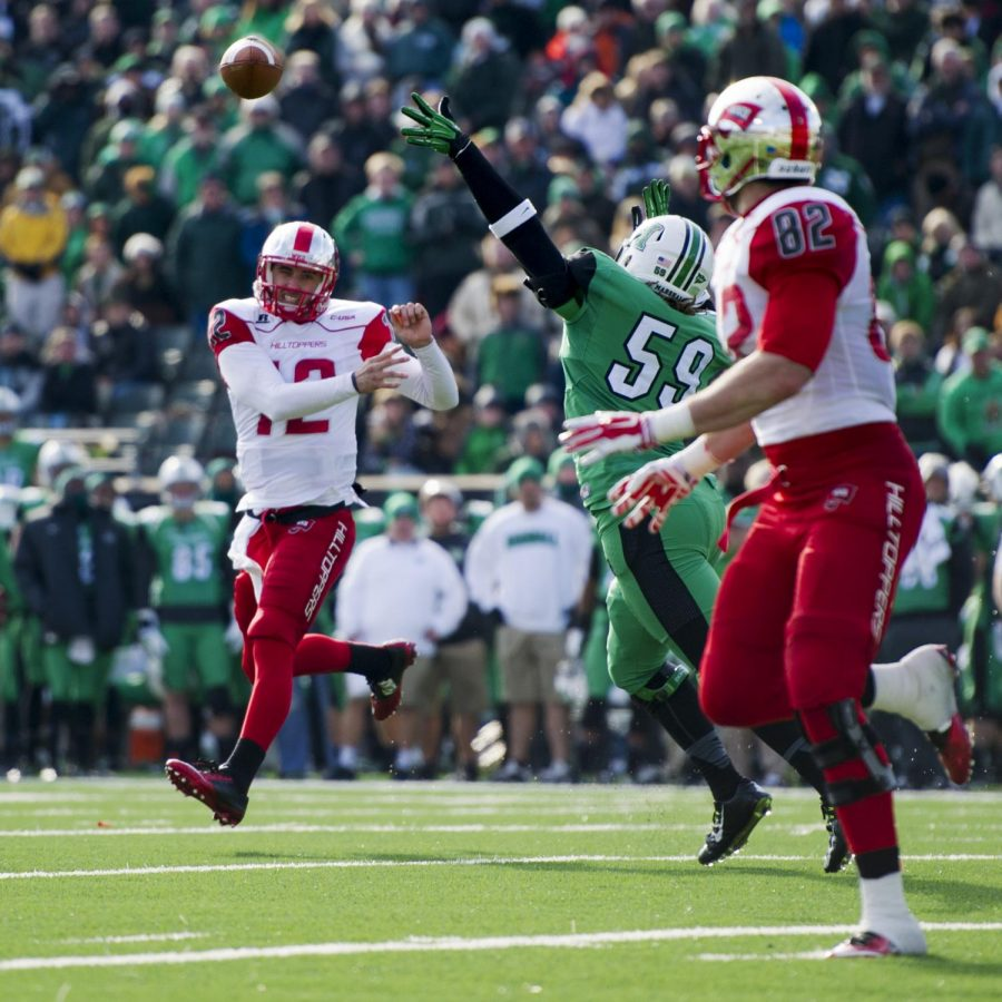 WKU's Brandon Doughty (12) releases the ball toward Tyler Higbee (82) during Friday's 67-66 overtime victory over No. 19 Marshall in Huntington, West Virginia. Higbee would catch the pass and score for a seven-yard touchdown.Nick Wagner/HERALD