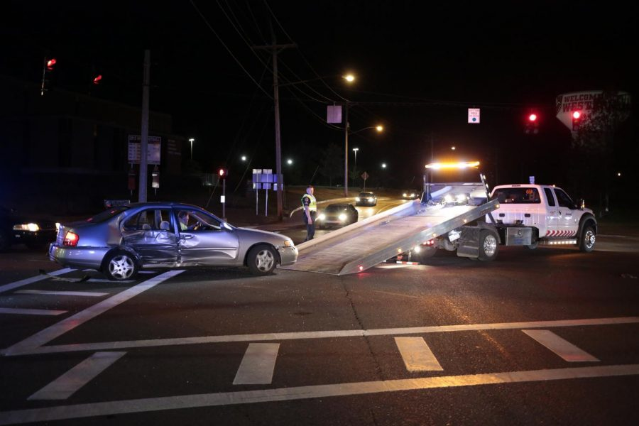 Two+vehicles+collided+at+the+corner+of+University+Blvd.+and+Russellville+Road+around+7p.m.+Sunday+night.+Both+drivers+were+able+to+walk+around+after+the+accident+occurred+and+were+most+likely+not+seriously+injured%2C+according+to+the+Bowling+Green+police+officers+who+responded+to+the+incident.+One+vehicle%2C+a+pick-up+truck%2C+was+able+to+drive+away+from+the+site+while+the+other%2C+a+Nissan+Altima+which+sustained+significant+damage+to+the+passenger+side%2C+was+removed+on+a+flatbed+truck+operated+by+Chris+Key+of+Jones+Automobile+and+Towing.+The+Nissan+Altima+was+traveling+northbound+on+University+Blvd.+and+was+turning+west+on+Russellville+Road+when+it+collided+with+the+truck+traveling+southbound+on+University+Blvd.+Leanora+Benkato%2FHERALD