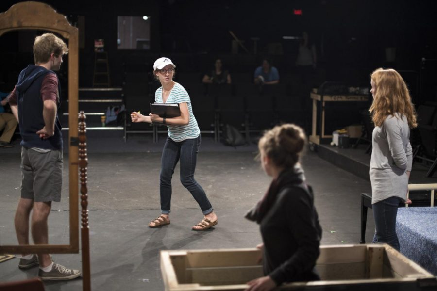Director Chandler Smith, center and facing, a senior from Paducah, instructs actors during a rehearsal for the WKU Children's Theatre production of Suzan Zeder's