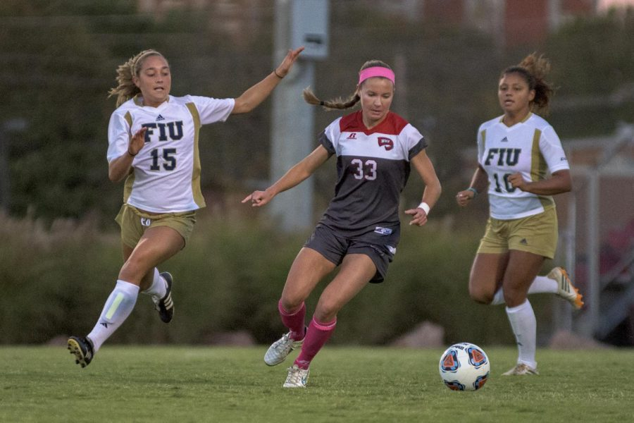 WKU%27s+midfielder+Nicole+Roseland%2C+%2833%29+keeps+the+ball+away+from+Florida+International+University%27s+forward+Talia+McMurtie+%2815%29+during+the+Lady+Topper%27s+1-0+double+overtime+win+Friday+at+the+WKU+Soccer+Complex.