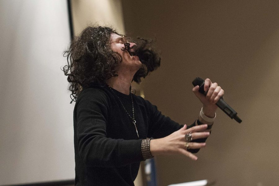 """As the opening act of the lip sync battle, Jay Todd Richey performs Ozzy Osbourne's """"Crazy Train."""" The competition was hosted by the WKU Counseling and Testing Center, Housing and Residence Life and the Barren River Area Safe Space. The event took place in the Mass Media Auditorium on Wednesday to raise awareness for domestic violence. Andrew Livesay/HERALD"""