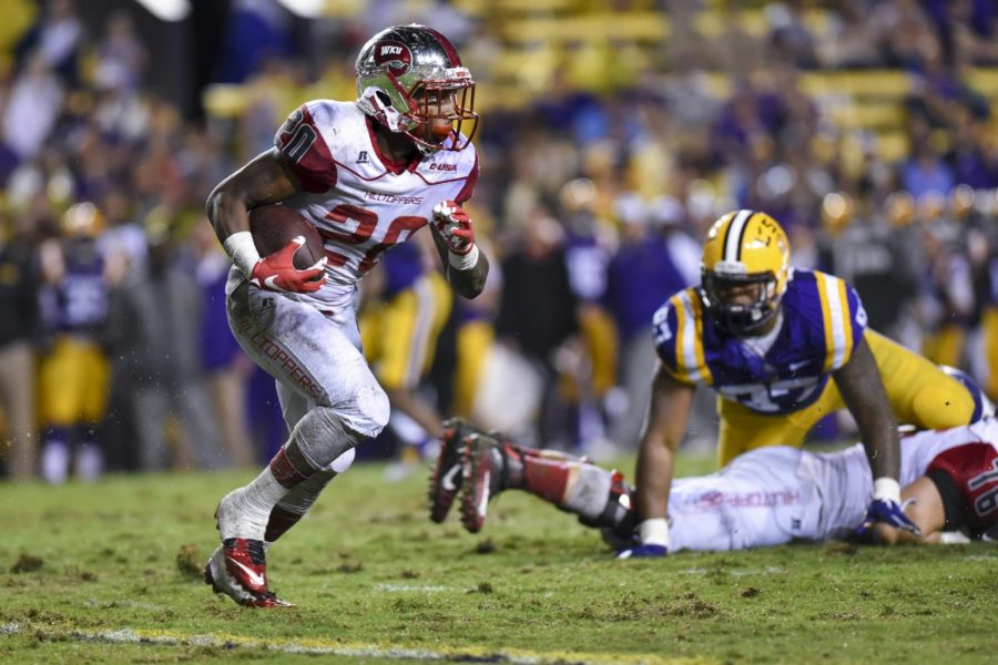 WKUs running back Anthony Wales, 20, runs the ball during the Hilltoppers 48-20 loss to LSU on Saturday at Tiger Stadium in Baton Rouge, La.