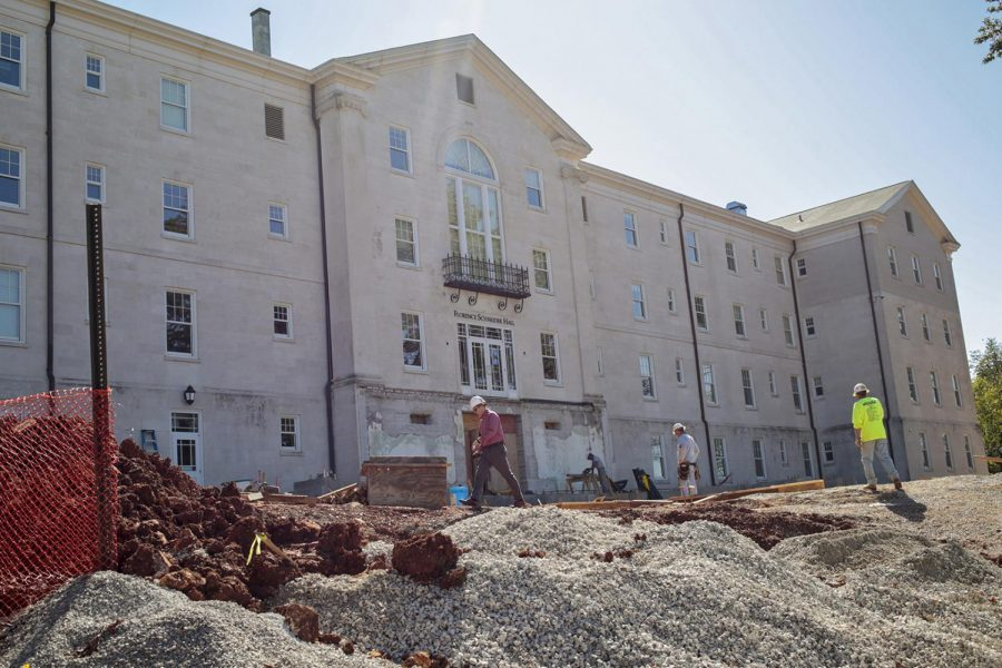 A construction crew works on new additions to the Gatton Academy, a pre-college boarding school focused on math and science, on Wednesday. Plans include extending two wings and the front entrance as well as interior renovations for additional living and learning space. Leanora Benkato/HERALD