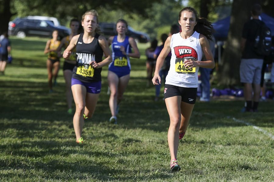 Senior Taylor Carlin from Alberta, Canada, front, runs in the Forrest Park Cross Country Festival at Forrest Park in St. Louis on Sept. 11. Ashley Cooper/HERALD