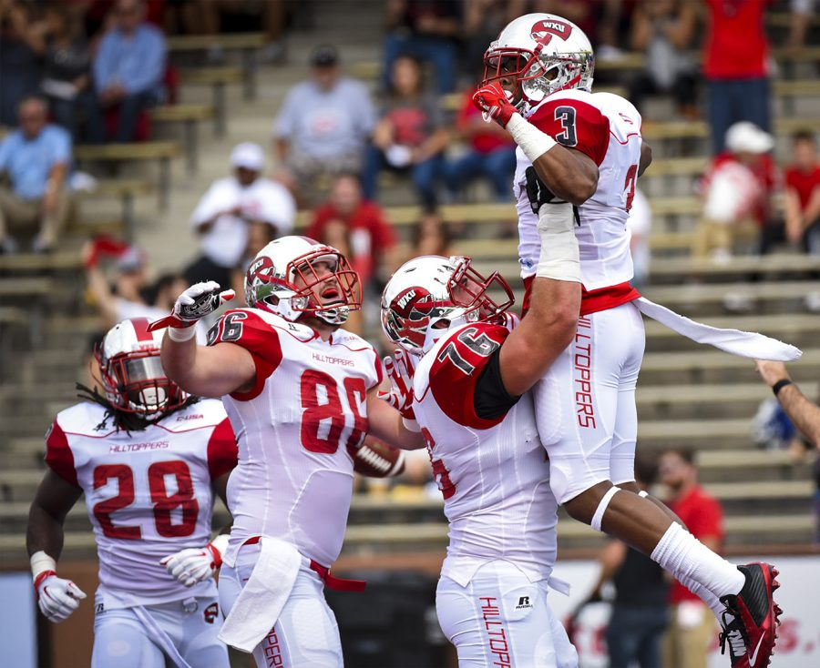 WKU+offensive+lineman+Forrest+Lamp+%2876%29+raises+wide+receiver+Antwane+Grant+%283%29+in+celebration+after+Grant+scored+a+touchdown+during+the+Hilltoppers%27+56-14+win+against+the+University+of+Miami+%28Ohio%29+on+Saturday+at+Houchens+Industries-L.T.+Smith+Stadium.