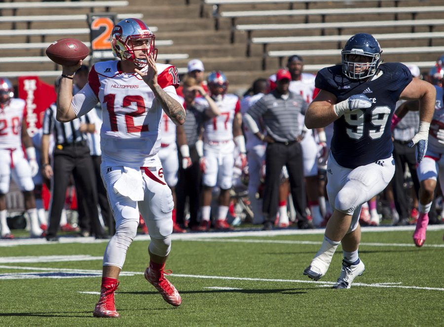 WKUs quarterback Brandon Doughty (12) goes back to pass during the Hilltoppers' 49-10 conference win over Rice University on Saturday at Rice Stadium in Houston. Sean Chu/Rice Thresher