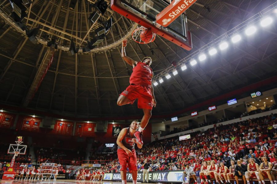 Junior+guard+Fredrick+Edmond+%2825%29+completes+a+dunk%2C+after+soaring+over+his+teammate%2C+redshirt+junior+Chris+Harrison-Dock%27s+%2851%29+body%2C+during+Hilltopper+Hysteria.+The+crowd+reacted+with+cheers+and+applause.+Alyssa+Pointer%2FHERALD