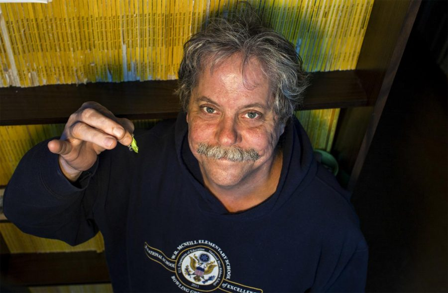 Chris+Groves%2C+distinguished+professor+of+hydrogeology%2C+also+has+expertise+in+raising+caterpillars.+He+and+his+daughters+study+the+caterpillars+metamorphosis+into+butterflies.+Weston+Kenney%2FSpecial+to+the+Herald