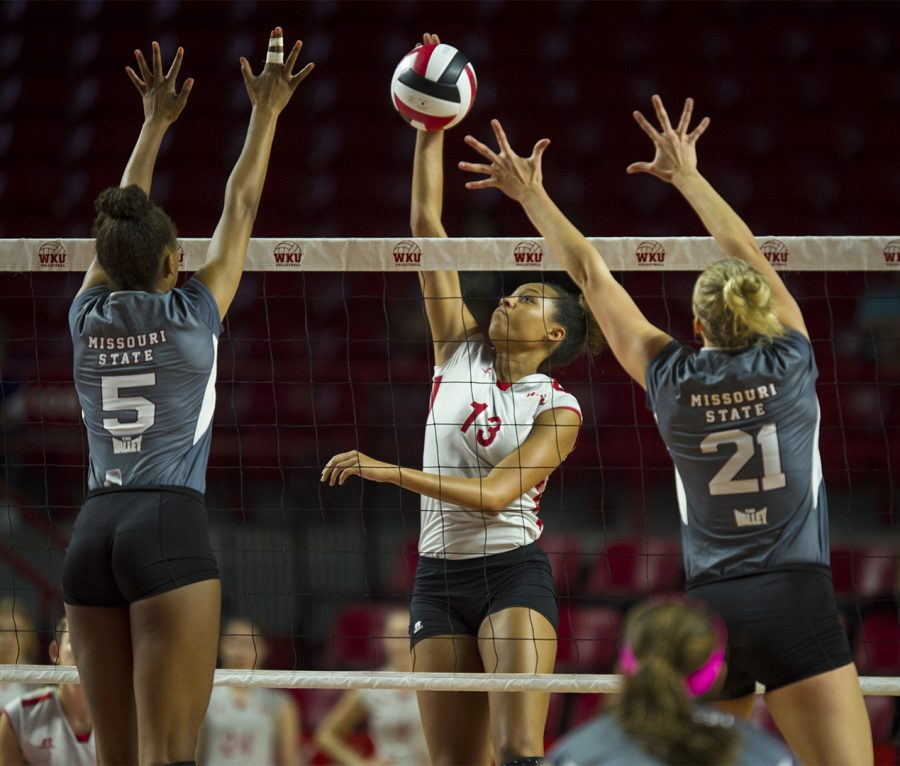 WKU+senior+Noelle+Langenkamp+%2813%29+spikes+the+ball+between+a+pair+of+Missouri+State+blockers+during+the+Lady+Toppers%27+2-3+loss+on+Friday+at+Diddle+Arena.+Nick+Wagner%2FHERALD