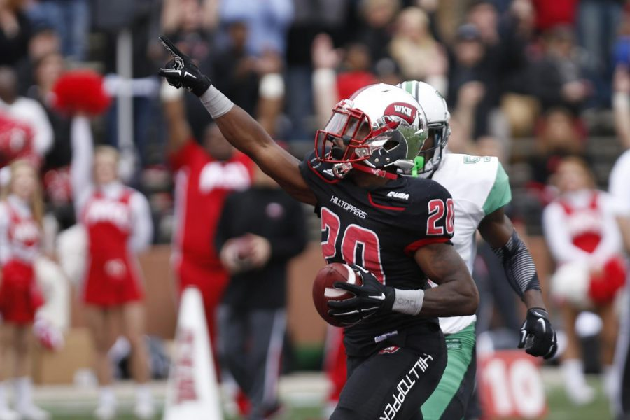 WKUs running back Anthony Wales (20) celebrates after trotting into the end zone during the Hilltoppers 49-28 win over Marshall on Friday at L.T. Smith Stadium. The Hilltoppers clinched the C-USA East Division championship with the win and will now host the C-USA Football Championship Game on Sat. Dec. 5.