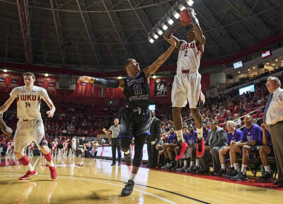 Western+Kentucky%27s+Aaron+Cosby+%282%29+shoots+a+3-point+shot+over+Kentucky+Wesleyan%27s+Ken-Jah+Bosley+%2811%29+during+Friday%27s+game+at+E.A.+Diddle+Arena.+The+Hilltoppers+won+the+homecoming+game+75-68.+Nick+Wagner%2FHERALD