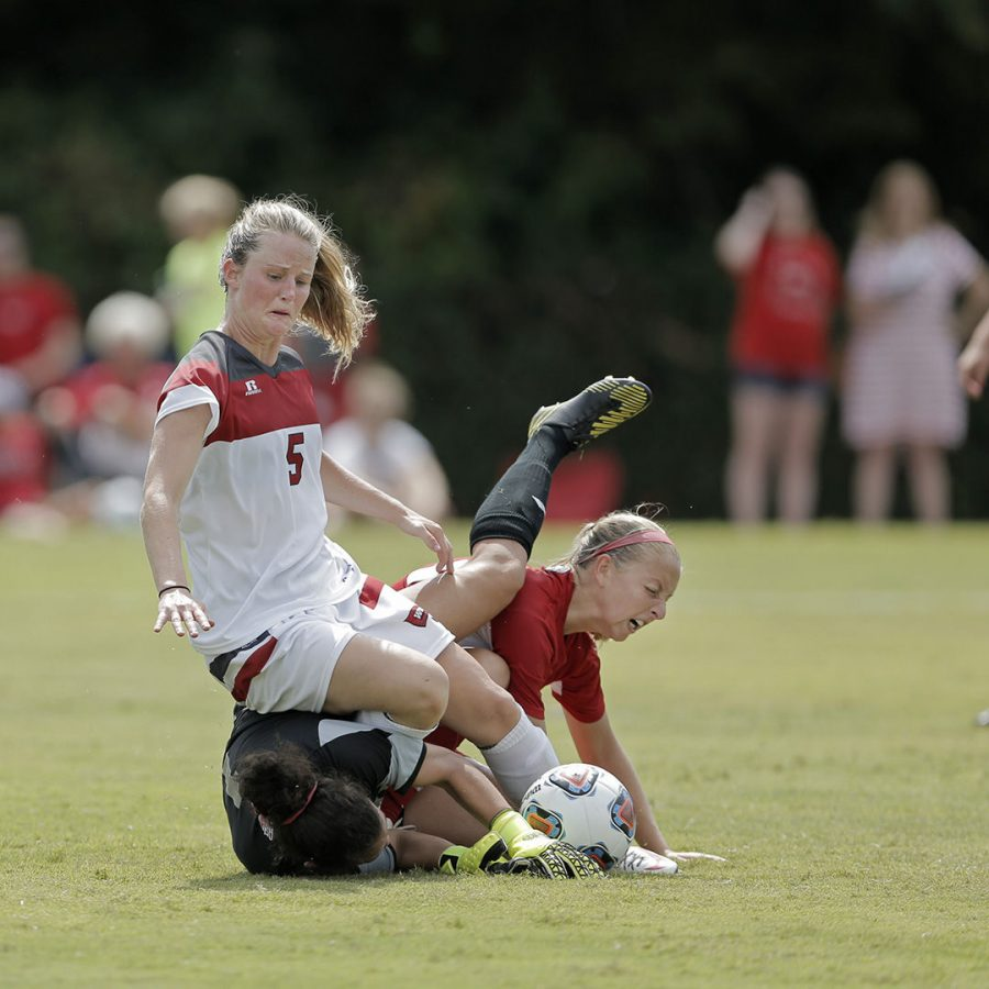 WKU's forward Lauren Moats (5) collides with Miami Universities defender Dana Miller (21) and goalkeeper Patricia Koutoulas (1) during WKU's 0-4 loss to Miami on Sunday Aug. 23, 2015 at the WKU Soccer Complex is Bowling Green, Ky.